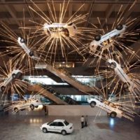 CAI Guo-Qiang, Inopportune: Stage One, 2004, Nine cars and sequenced multichannel light tubes, Dimensions Variable
