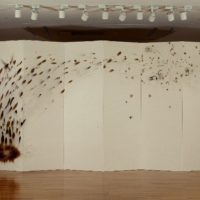 CAI Guo-Qiang, Golden Missile, 1998, Gunpowder on paper, mounted on wood as six-panel screen, 218.5 x 450 cm